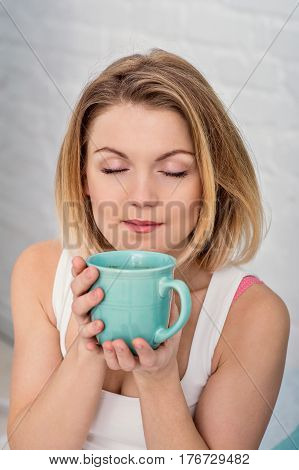 Morning with a cup in woman hands. Happy woman in a cup in his hands