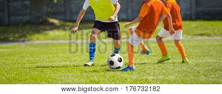Soccer Football Match. Kids Playing Soccer. Young Boys Kicking Football Ball on the Sports Field. Kids Playing Soccer Training Game on the Pitch. Youth European Football Match
