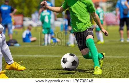 Football Soccer Match for Children. Kids Playing Soccer Game Tournament. Boys Running and Kicking Football. Youth Soccer Coach in the Background