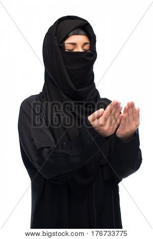 religion, faith, islam and people concept - praying muslim woman in hijab over white background