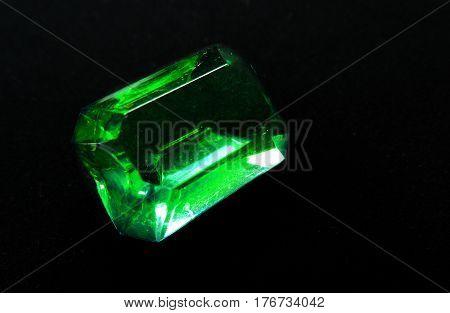 green emerald gem crystal precious jewel on black background