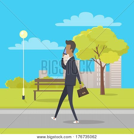 Businessman in suit and with briefcase walks in city park and talks by phone. There is bench streetlight, tree and bushes, clouds and skyscrapers behind him. Vector illustration of cartoon character.