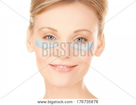 beauty, cosmetology, hydration, people and rejuvenation concept - close up of beautiful young woman face with hydrogel under-eye patches over white background