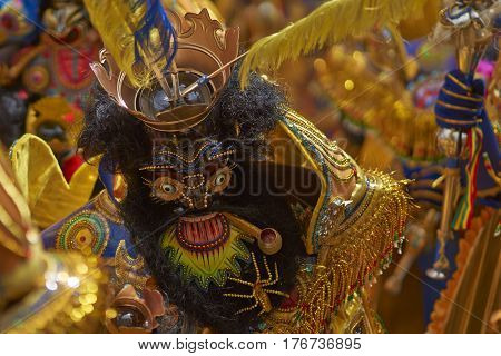 ORURO, BOLIVIA - FEBRUARY 25, 2017: Morenada dancers in ornate costumes parade through the mining city of Oruro on the Altiplano of Bolivia during the annual carnival.