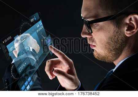 business, people and modern technology concept - close up of businessman with smartwatch and virtual screen projection over black background