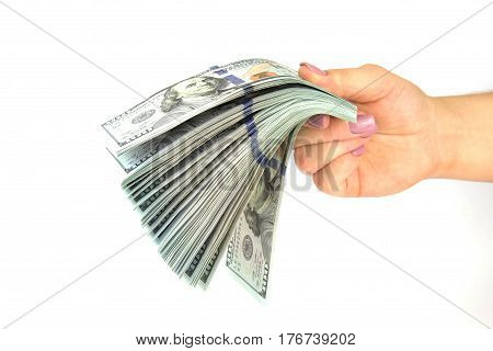Female hand hold many dollars banknotes on a white background