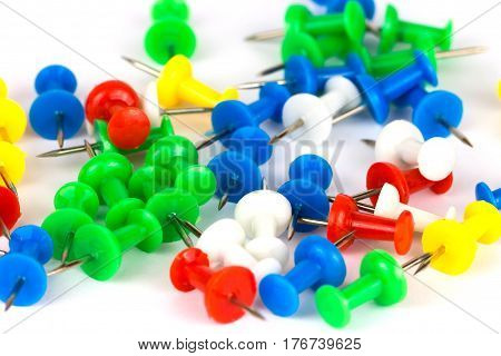 Colorful pins isolated on a white background. Close up