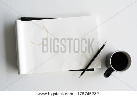 Drawing Pad Pencil Coffee Cup On A White Table