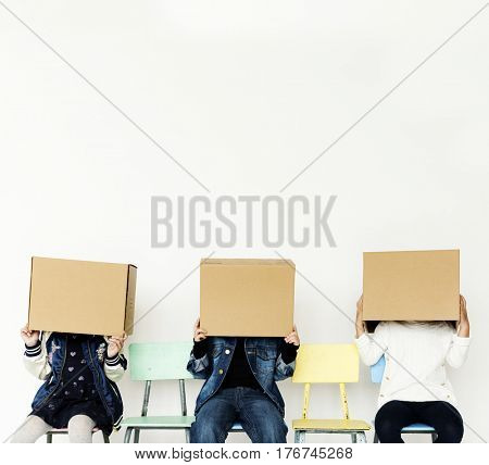Group of Kids Box Cover Head Hiding Gesturing