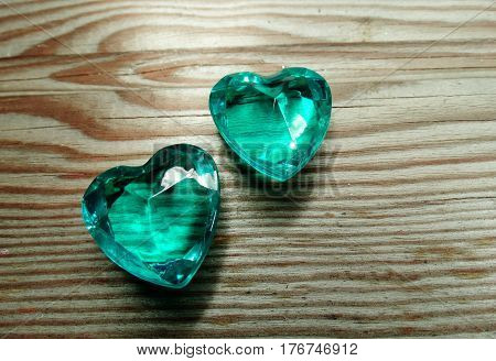 sapphire gem hearts on old wood background love concept
