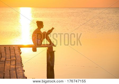 Girl At The Pier