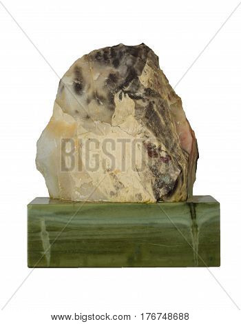 Russian Ural minerals: Greenish-gray Jasper mineral on the bar of ofiokaltsit (green marble with ofit inclusions) isolated.