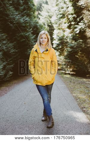 Carefree woman standing in forest