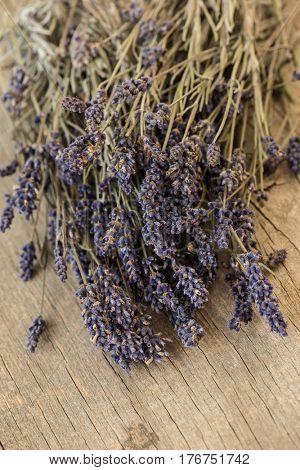 Bundle of lavender on rustic wooden background