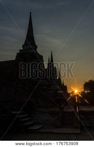Silhouette Pagodas with sun stars in Wat Phra Sri Sanphet Ayuthaya Thailand