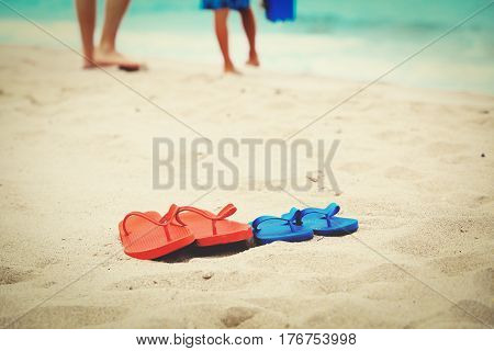 father and son walking at beach, family vacation concept