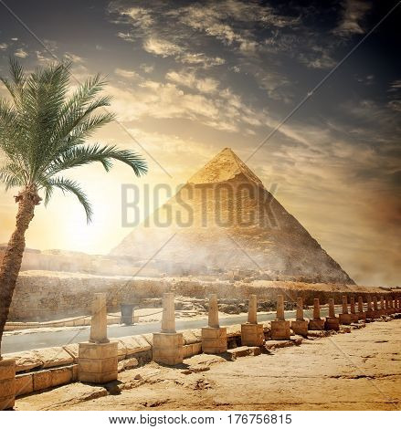 Pyramid of Khafre near road at sunlight