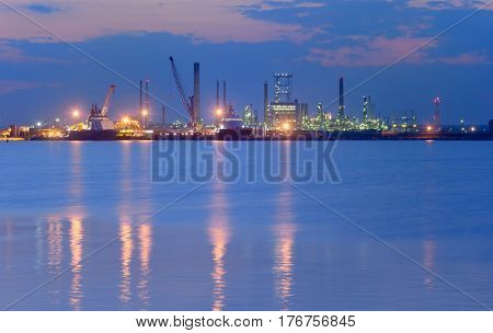 Industrial Petrochemical plant and sea in night time