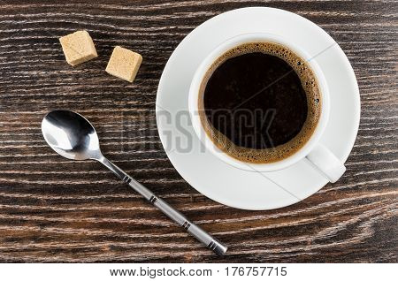 Coffee In Cup On Saucer, Lumpy Sugar And Spoon