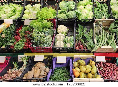Large market stall full of organic vegetables