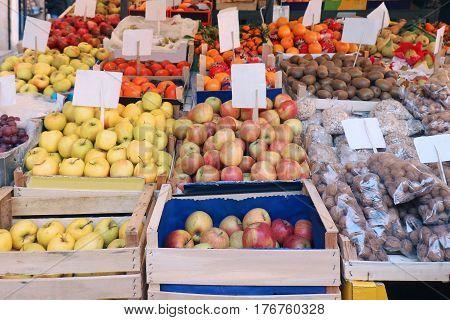 Fresh organic fruits piles sold on market stall