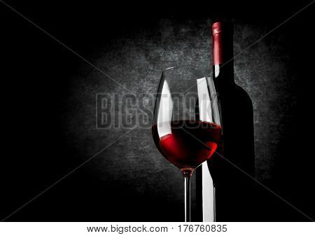 Wineglass of red wine on a black background