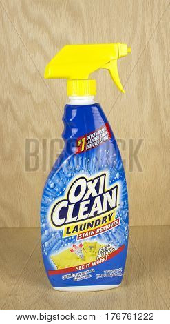 RIVER FALLS,WISCONSIN-MARCH,17 2017: A bottle of OxiClean brand laundry stain remover with a wood background.