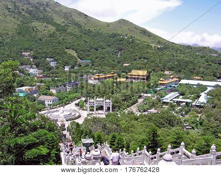 Ngong Ping, Hong Kong - March 24, 2003: View over the Ngong Ping Plateau with the Buddhist Po Lin Monastery on the island of Lantau in Hong Kong.