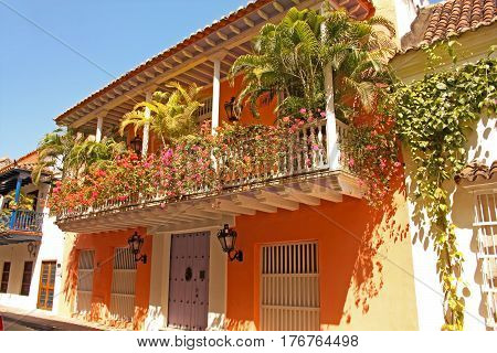 Detail of a colonial house. balcony with flowers. Spanish colonial home. Cartagena de Indias Colombia. In 1984 Cartagena's colonial walled city and fortress were designated a UNESCO World Heritage Site.