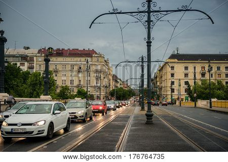 BUDAPESHT, HUNGARY- JULY 08: Cars moving down the street of Budapest, Hungary, later in the evening, cloudy on july 08, 2015 in Hungary