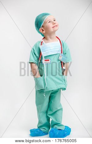 Portrait of young smiley nurse boy with stethoscope