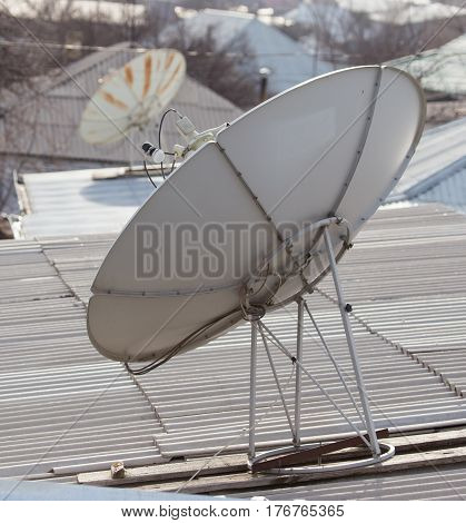 parabolic antenna on the roof . Photo texture