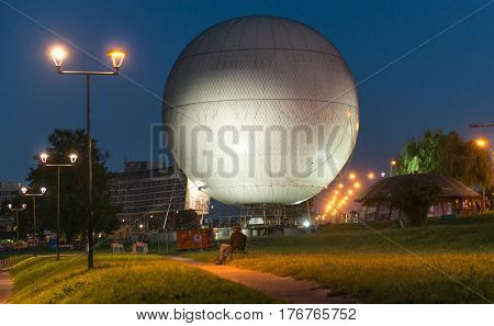 POLAND, KRAKOW- JULY 03: Park air balloon sitting on the grass, taken late at night in Krakow Poland on July 03, 2015