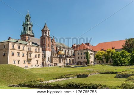 POLAND, KRAKOW- JULY 03: Beautiful ancient catholic cathedral surrounded by the gardens and green areas in Krakow Poland on July 03, 2015