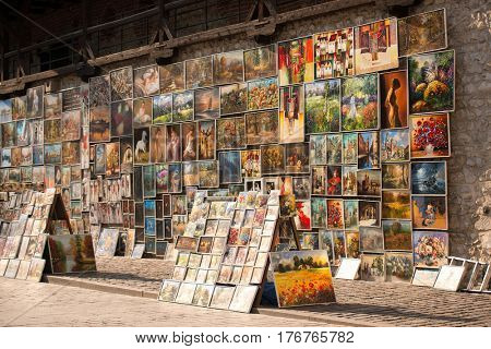 POLAND, KRAKOW- JULY 01: Beautiful pictures and photos for sale on display on the cobbled street in Krakow Poland on July 01, 2015