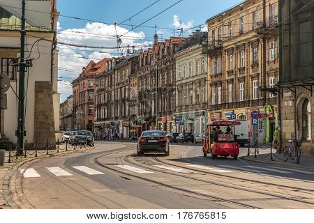 POLAND, KRAKOW- JULY 02: Movement of transport on a narrow cobbled street on a sunny day in Krakow Poland on July 02, 2015