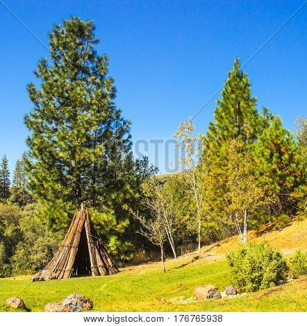 American Indian Tepee Lodge At Base Of Hill