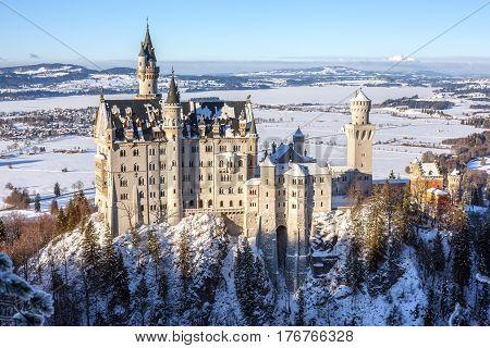 Neuschwanstein castle view from Maria bridge winter evening light Bayernland Germany.
