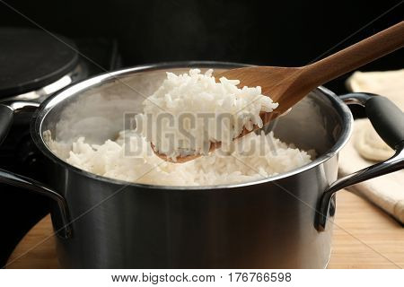 Cooked rice in metal saucepan, closeup