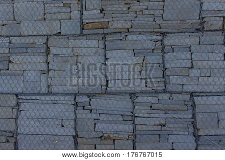 Original stone wall background. Stone wall texture seamless