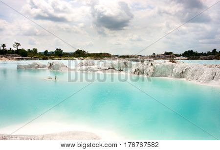 Man-made artificial lake Kaolin turned from a mining ground holes. Land contains kaolinite and is white. Due to mining holes were formed. and were covered by rain water forming a clear blue lake Air Raya Village Tanjung Pandan Belitung Island.