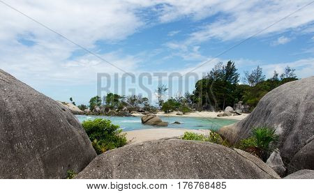 Natural rock formation on white sand beach in Belitung Island in the afternoon Indonesia.