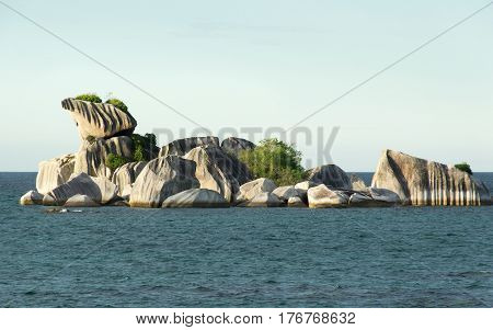 Natural granite rock formation at sea in the afternoon Belitung Island Indonesia.