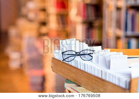 Card catalogue with eyeglasses at the library. Image with copy space