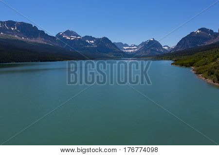 beautiful view of saint mary lake and rocky mountains in glacier national park montana usa viewpoint at going-to-the-sun road