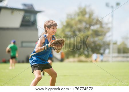 young preteen boy playing softball on outdoor background
