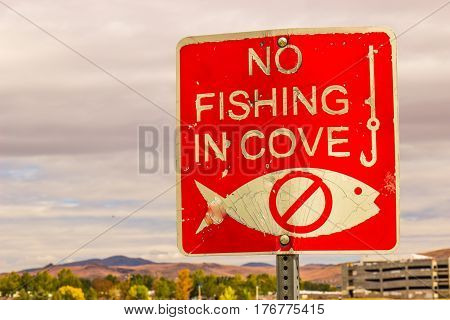 Red & White No Fishing In Cove Sign