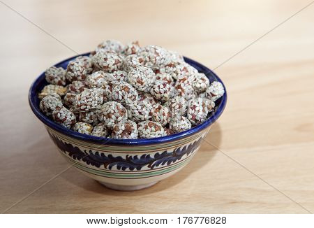 Nuts covered with honey and sesame in an oriental bowl
