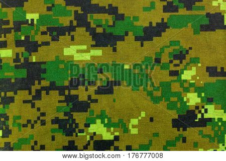 Closeup camouflage pattern for hiding, disguising. Detailed of digital camo texture