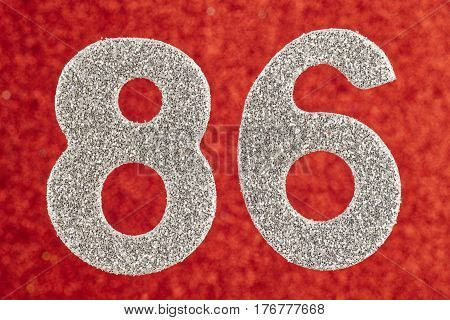 Number eighty-six silver color over a red background. Anniversary. Horizontal
